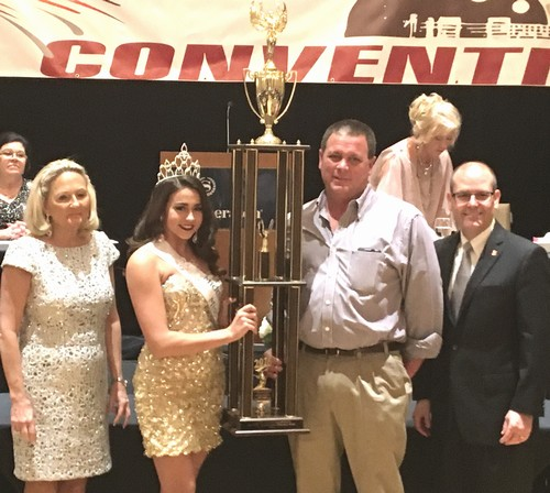 Fairst of the Fair Cheyenne Johnson and Heath Hill accept the 2016 Champion of Champions Trophy