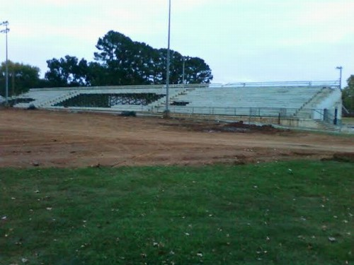 Old grandstand coming down.